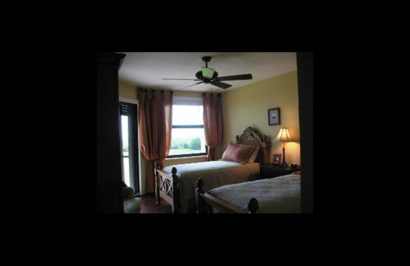 Vacation rental bedroom at Sunshine Resort Rentals, LLC.
