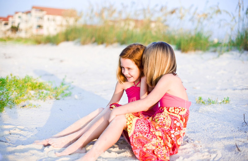 Kids on beach at Resort Vacation Properties of St. George Island.