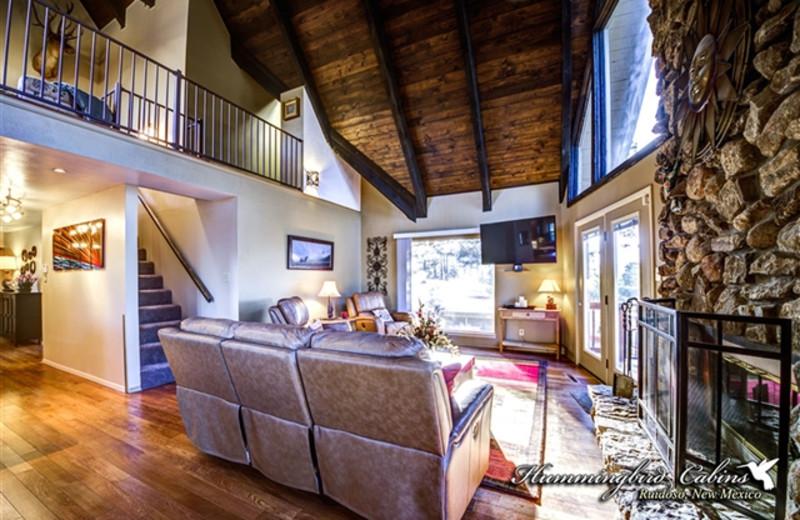 Living room and loft at Hummingbird Cabins - Holly House Vacation Rental