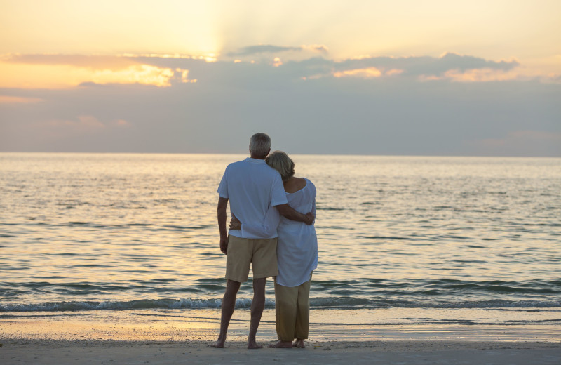 Couple on beach at VIP Vacation Rentals LLC.