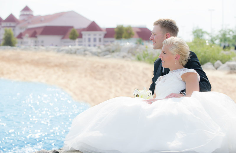 Wedding couple on beach at Blue Harbor Resort and Spa.