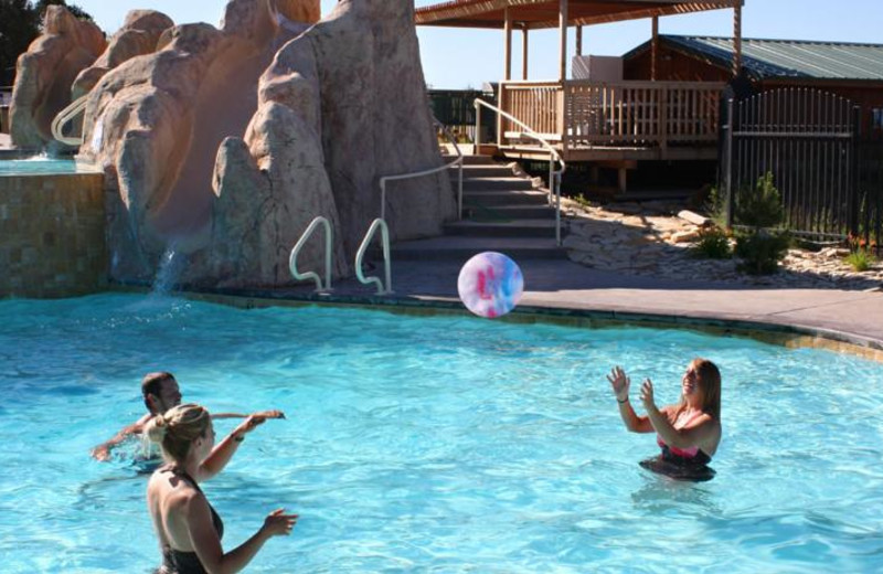 Family playing in pool at Zion Ponderosa Ranch.
