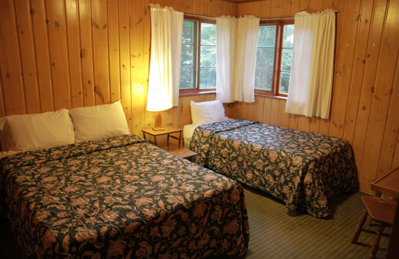 Cabin bedroom at Holiday Acres Resort.
