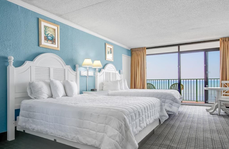 Guest room at Sand Dunes Resort Hotel.