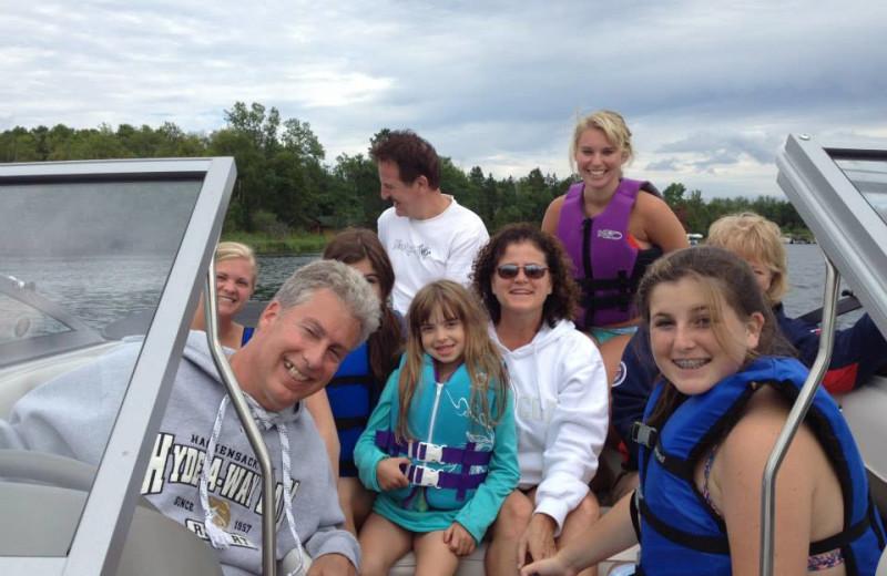 Family boating at Hyde-A-Way Bay Resort.