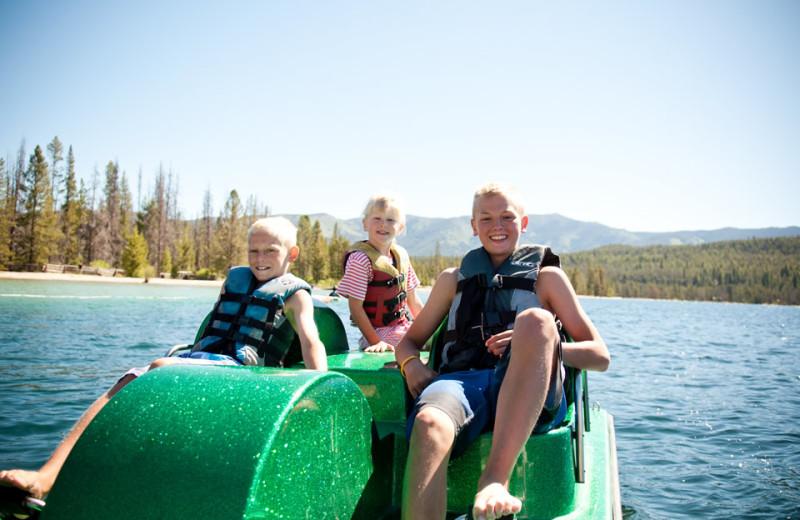 Family paddle boating at Redfish Lake Lodge.