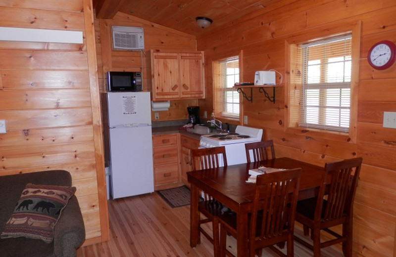 Cabin kitchen and dining area at American Pines Cabins.