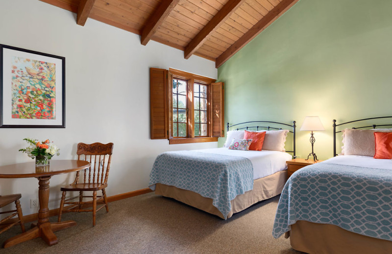 Features include double queen beds, walk in shower, sitting area and gas fireplace.