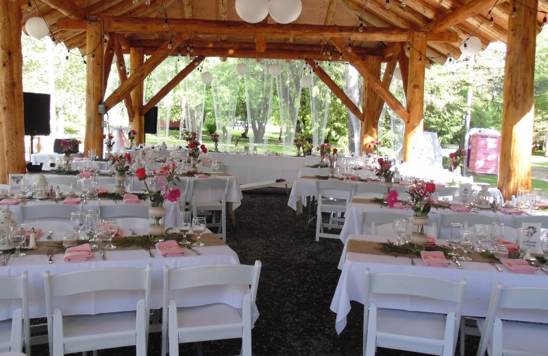 Wedding Reception at Rainbow Point Pavilion.  A beautiful setting for a special day.  The log Pavilion gives warmth and charm to the reception at this outdoor wedding at the Lodge