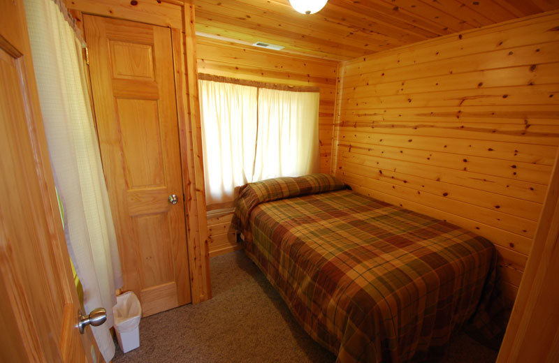 Cabin bedroom at Birch Forest Lodge.