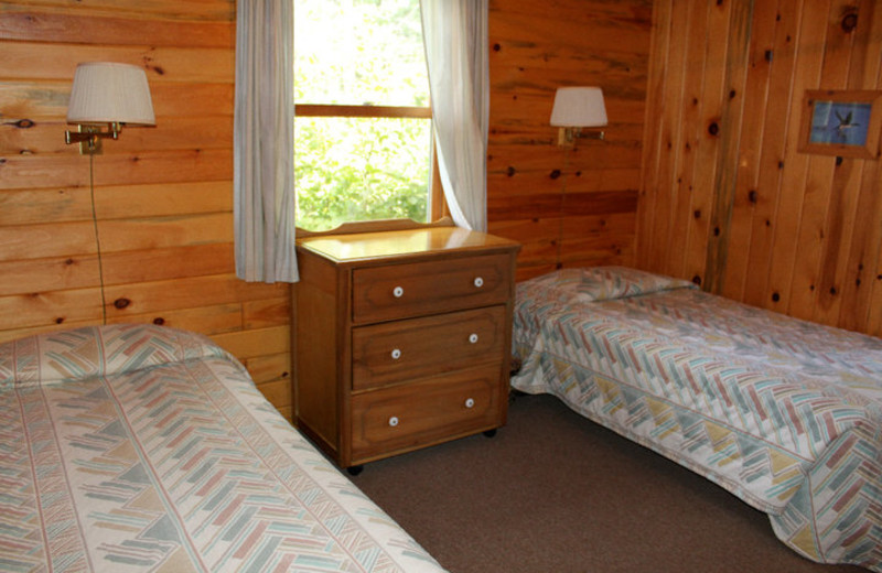 Cabin bedroom at Muskego Point Resort.
