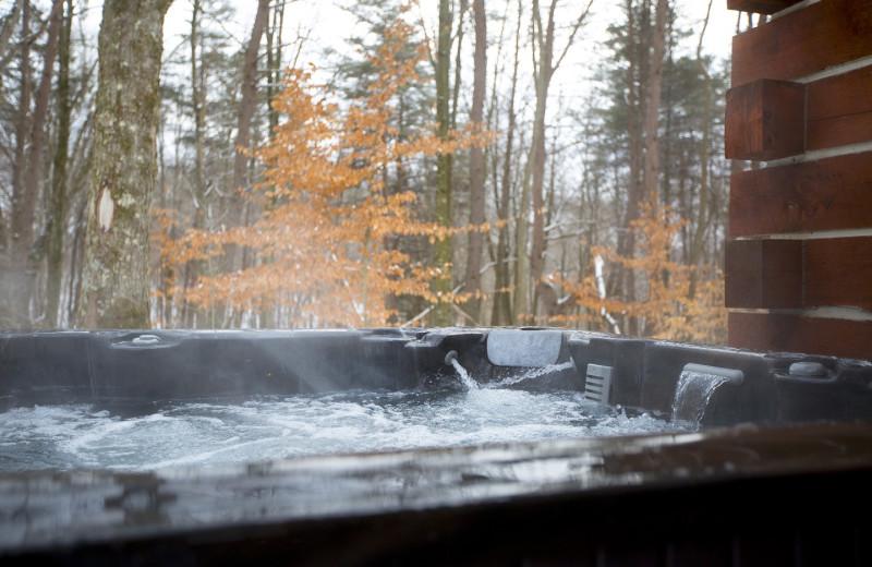 Cabin hot tub at Aspen Ridge.