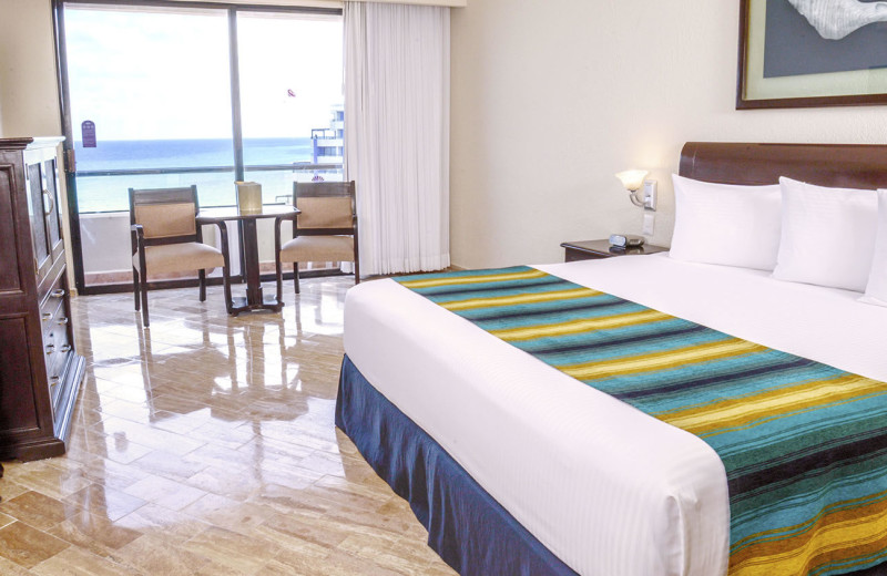 Guest room at Crown Paradise Club Cancun.