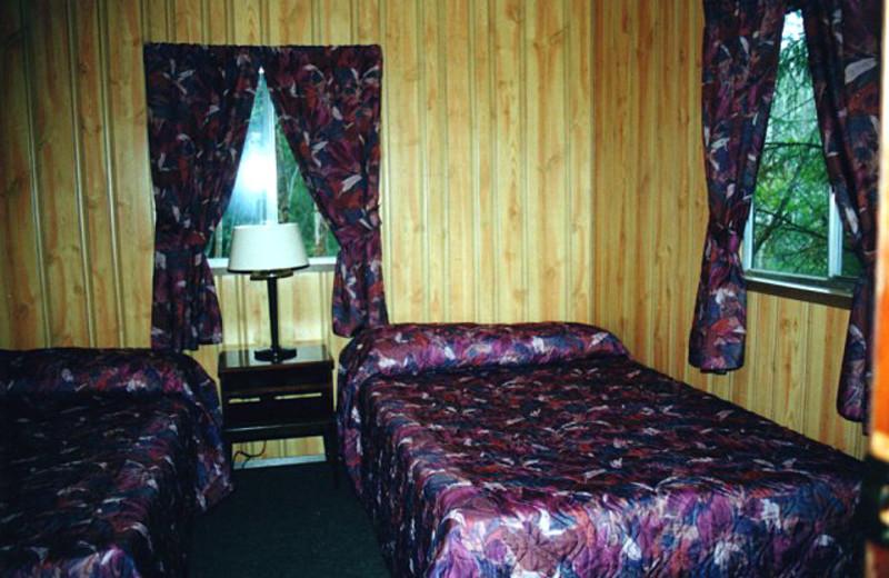 Cabin bedroom at Uchi Lake Lodge.