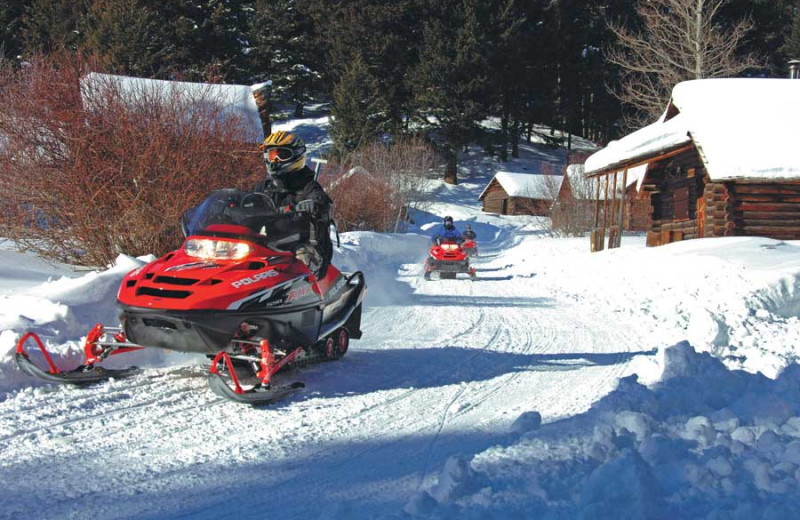 Snowmobiling at The Resort at Paws Up.