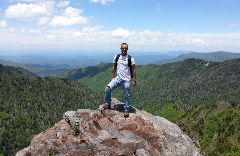Hiking in the mountains at Cabin Fever Vacations.
