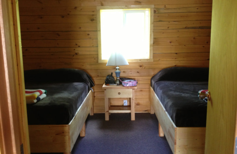 Cabin bedroom at Maynard Lake Lodge and Outpost.