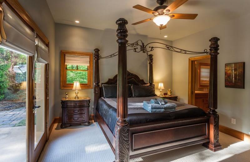 Cabin bedroom at Mountain Oasis Cabin Rentals.