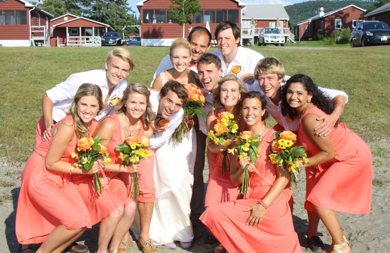 Bridal party on the sandy beach at Jackson's Lodge and Log Cabin Village.