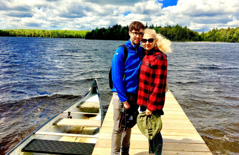 Couple on dock at Algonquin Log Cabin.
