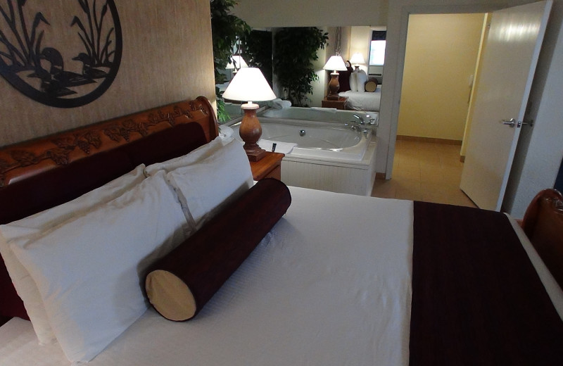 Guest bedroom at The Cherry Tree Inn & Suites.