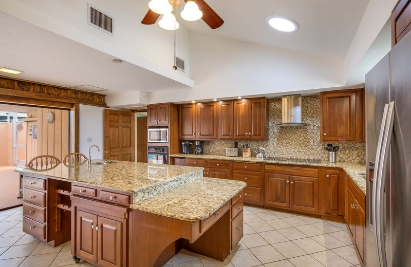 Rental kitchen at Sun Palace Vacation Rentals.