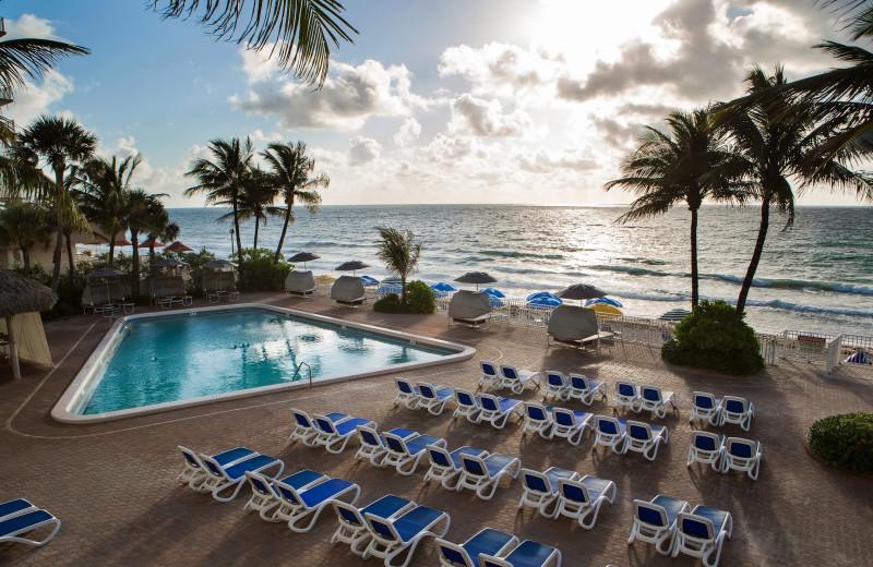 Outdoor pool deck at Ocean Sky Hotel & Resort.