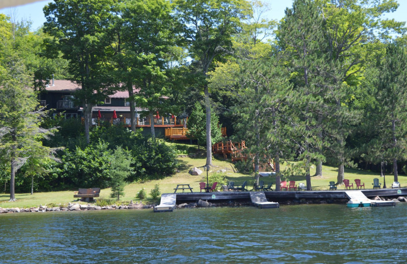 Exterior view of Heather Lodge from the lake, 150 feet of shoreline with a large dock to enjoy!