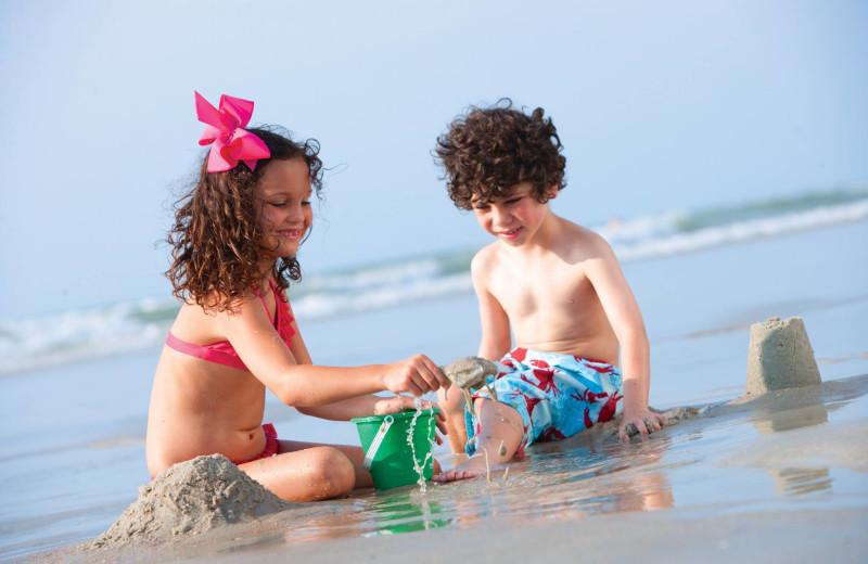 Kids on beach at Caribbean Resort & Villas.