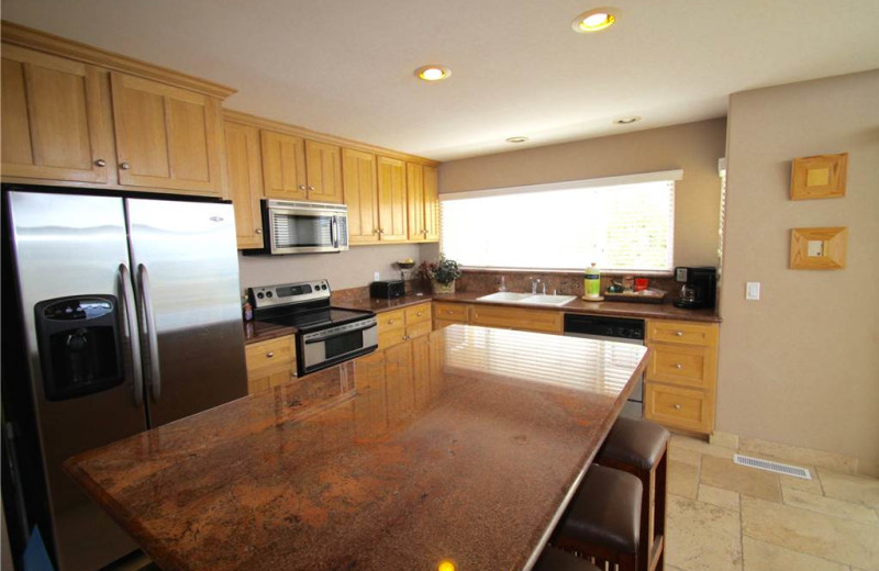 Rental kitchen Vacation Rentals by McLain Properties.