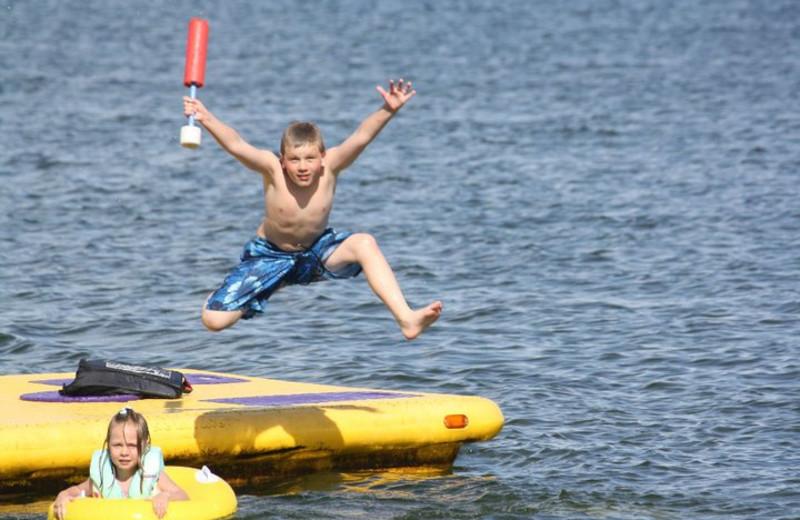 Jumping in the lake at Barky's Resort.