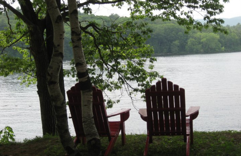 Relax by the lake at The Elms Waterfront Cottages.