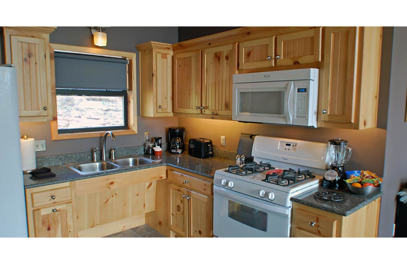 Cabin kitchen at Beaver Lakefront Cabins.