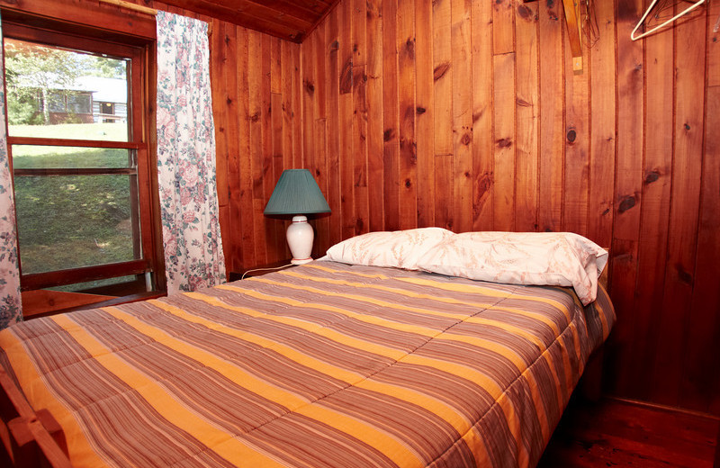 Cabin bedroom at Fernleigh Lodge.