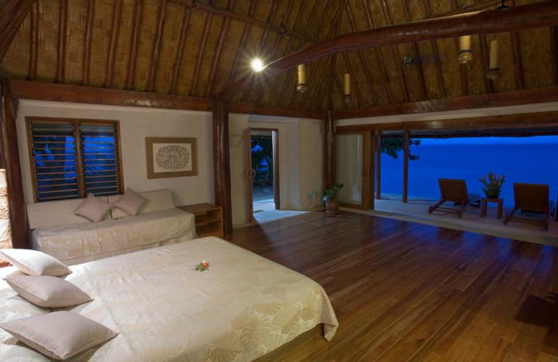 Cottage interior at Toberua Island Resort.