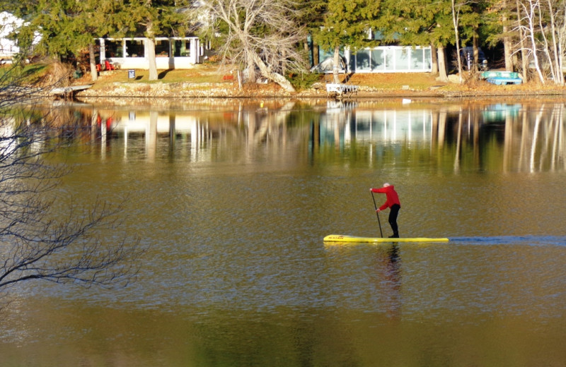 Paddle boarding at HighWinds Lodge & Cottages.