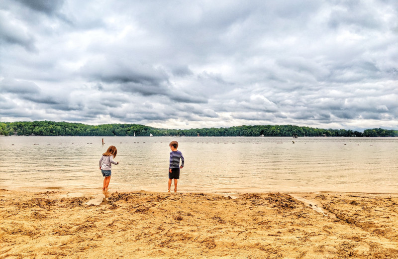 Kids on beach at The Osthoff Resort.