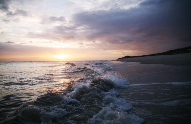 Beach sunset at Bald Head Island Limited.