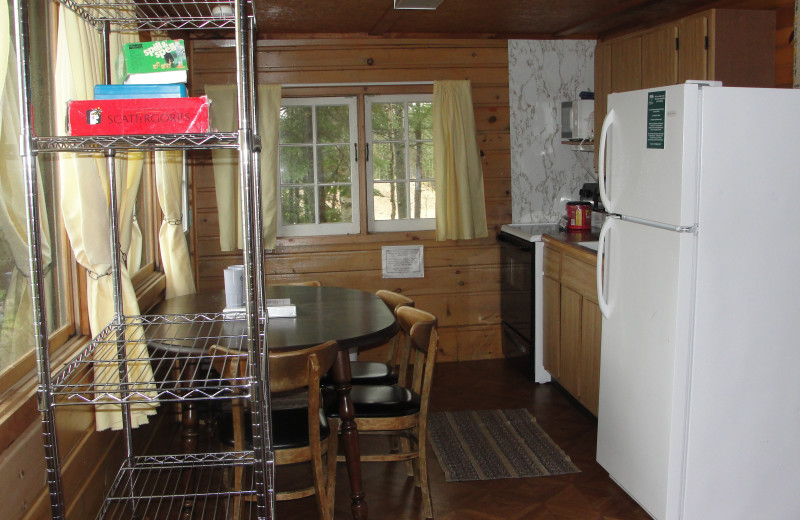 Cottage kitchen and dining area at Pine Point Lodge.