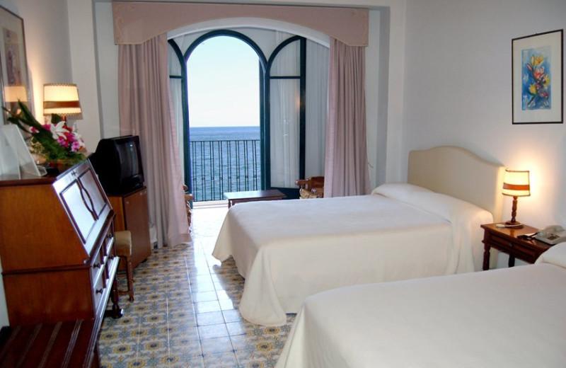 Guest room at Hotel Lido Méditerranée.
