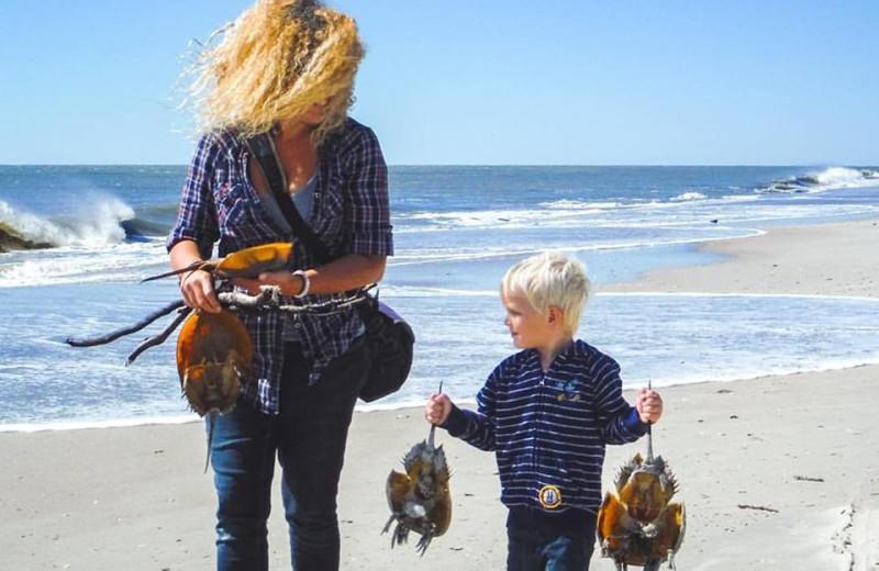 Family fishing a tRealty World - First Coast Realty.