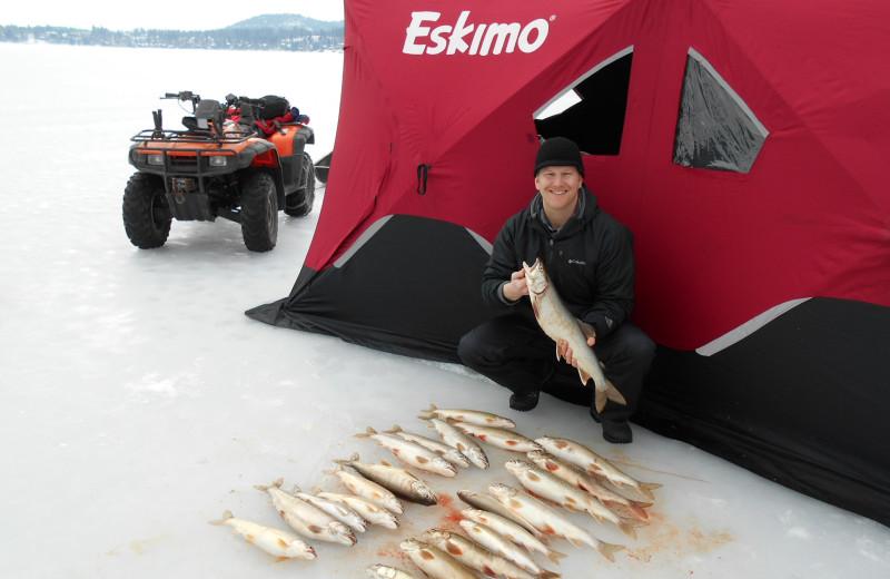 Ice fishing at The Lodge at Whitefish Lake.