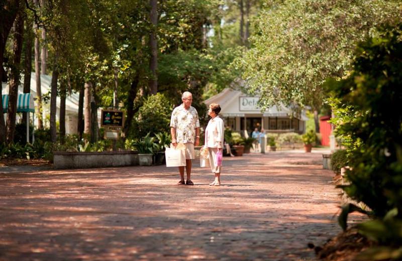 Couple shopping near Grande Shores Ocean Resort.