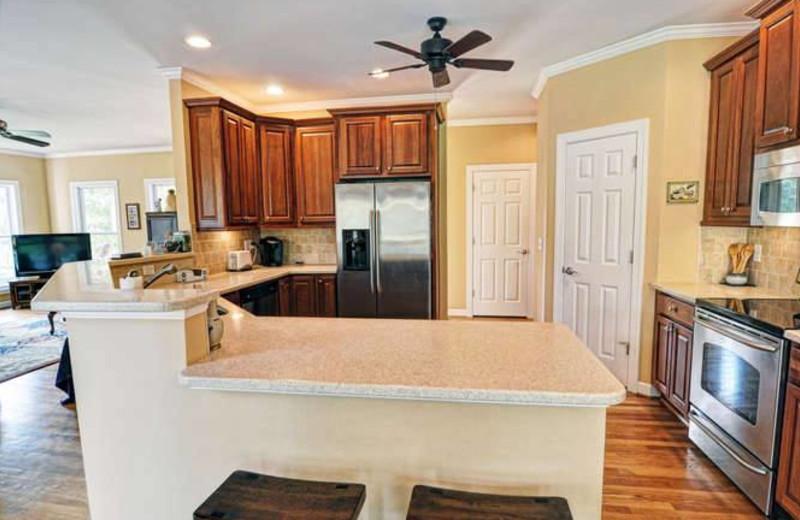 Vacation rental kitchen at Century 21 Action Inc.