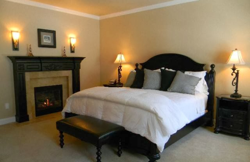 Guest bedroom with fireplace at Summer Creek Inn & Spa.