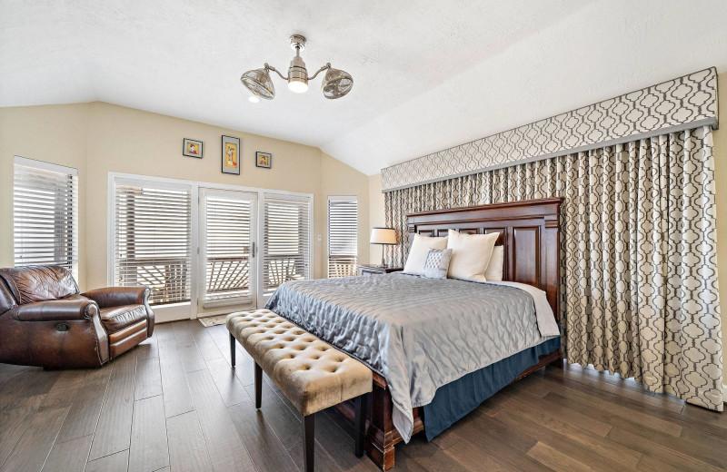 Rental bedroom at Gary Greene Vacation Rentals.