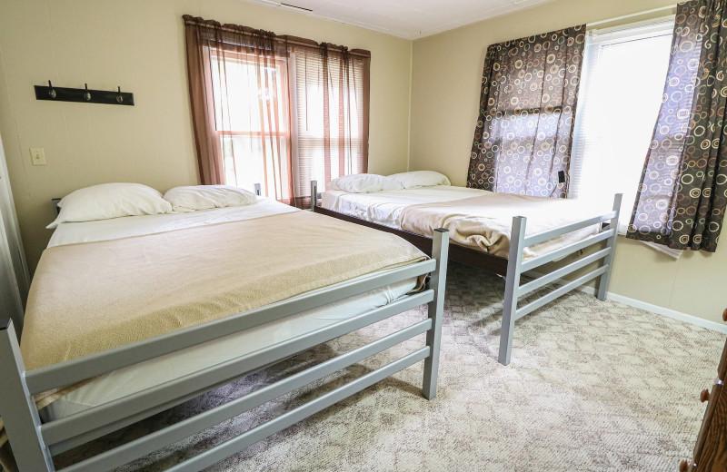 Cabin bedroom at Sand Lake Resort.