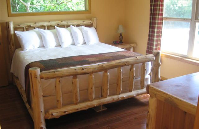 Master bedroom at Red Cedar Lodge.A king sized bed, abundant pillows and triple sheeted with a duvet comforter say, ah.... luxury!