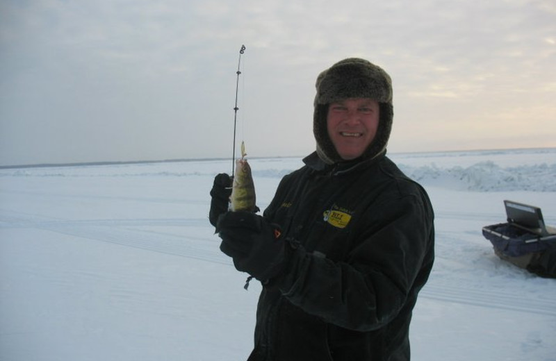 Fishing on the ice at Appeldoorn's Sunset Bay Resort.