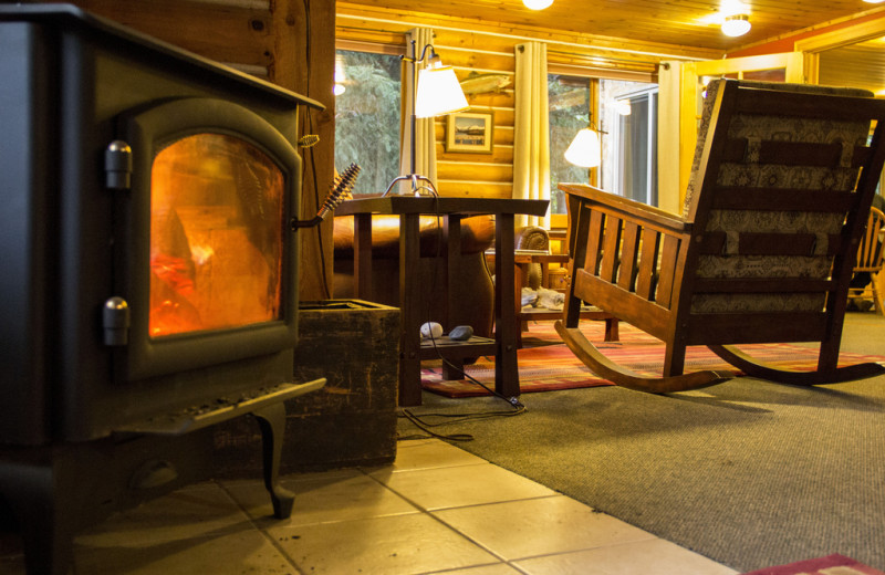 Lounge with fireplace at Kenai Riverside Lodge.